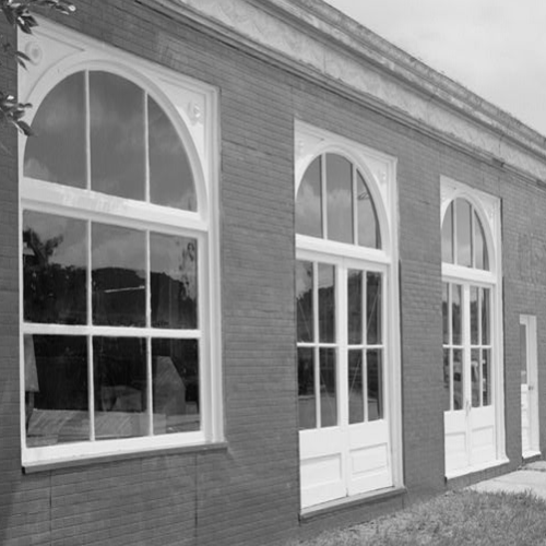 SOUTH FRONT OF FACTORY BUILDING ON CENTRAL AVENUE, LOOKING NORTHEAST, SHOWING WINDOWS, THREE ENTRANCE DOORS,